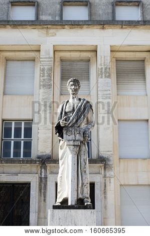 Statue in front Facultade de Letras in Coimbra University Portugal