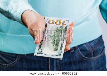 man holding hundred-dollar bills in his hands, money