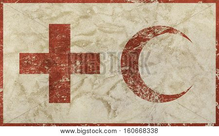 Old grunge dirty background with vintage faded shabby distressed flag of international non-governmental humanitarian organization