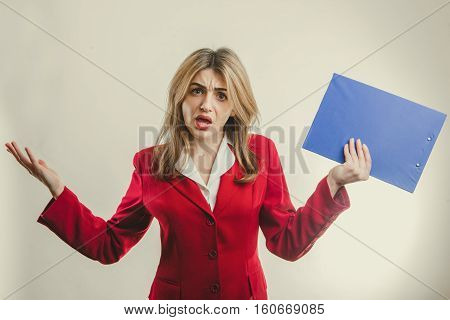 Cute business girl in red jacket feels discontent
