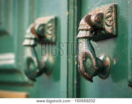 Old hand shaped metal door handles in Bairro Alto Lisbon Portugal