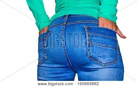 Rear view of the young woman wearing blue jeans