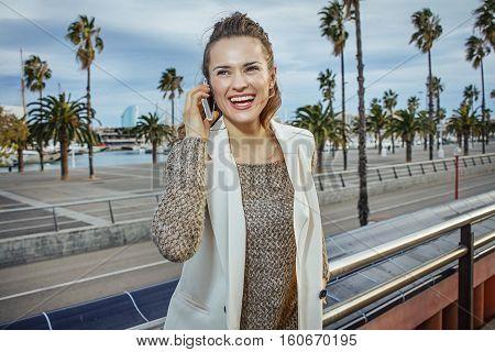 Fashion-monger On Embankment In Barcelona Speaking On Cell Phone