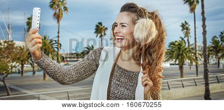 Woman In Barcelona, Spain Taking Selfie With Smartphone