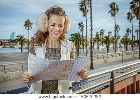 Happy Modern Woman In Barcelona, Spain Looking At Map