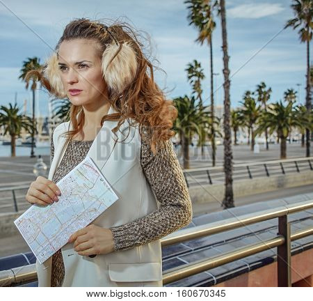 Young Fashion-monger In Earmuffs In Barcelona, Spain With Map