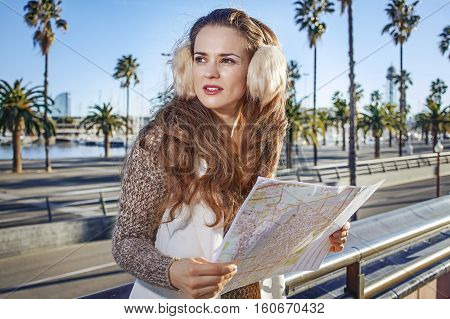 Woman In Barcelona, Spain With Map Looking Into Distance