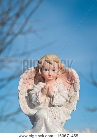 One Guardian angel on blue sky background. Religion and faith concept