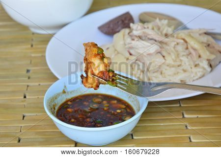 steamed chicken stab in fork dressing spicy sauce