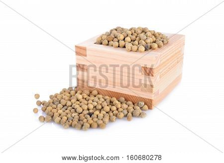 dry pepper in wooden box and on white background