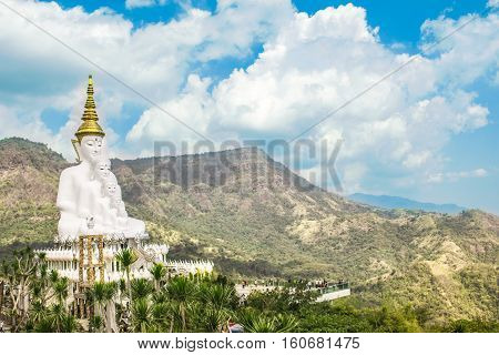 Landscape with Buddha statue in the country in Thailand during the day.