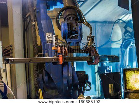 Robot handles automotive parts in factory Industrial automotive