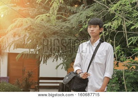 Portrait of handsome young man tourism with sunset light tone