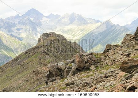 Views of large rocks against a mountain pass in Dombai