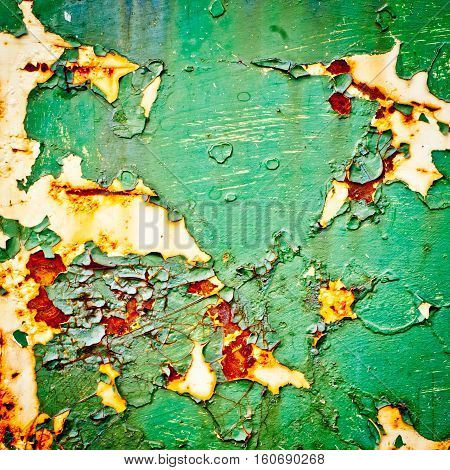 Grunge texture background. Old paint texture. Rusty metal with peeling paint. Green abstract painting.