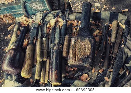 Old wood carving tools. Workplace background. Set of wood chisel for carving wood sculpture tools on wooden.Craftsmanship in Sri Lanka.