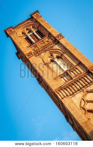 Church tower street view. San francesco abbey bell tower. Bologna Italy.