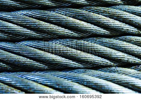 Industrial abstract background. Blue Steel cable close-up photo. New rope lubrication.