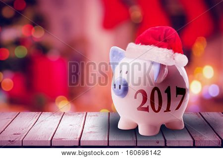 Digital image of new year 2017 against composite image of floorboard