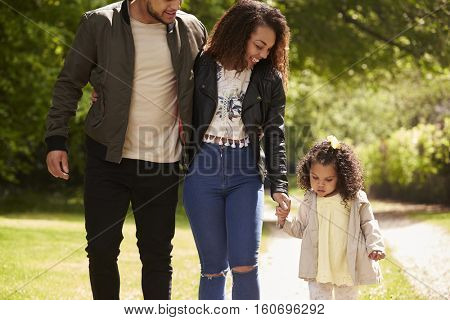 Couple with young daughter on a country walk, close up, crop