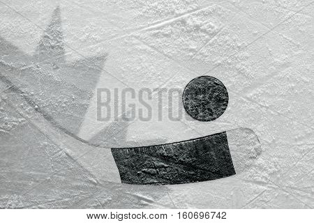 Hockey puck stick and the image of the Canadian flag on the ice. Concept