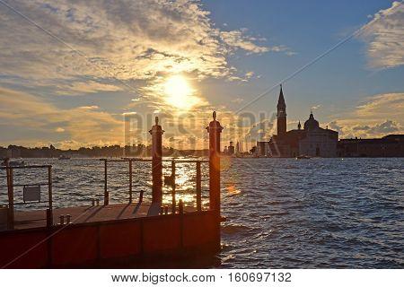 romantic view of the Grand Canal and basilica San Giorgio Maggiore in Venice on sunset