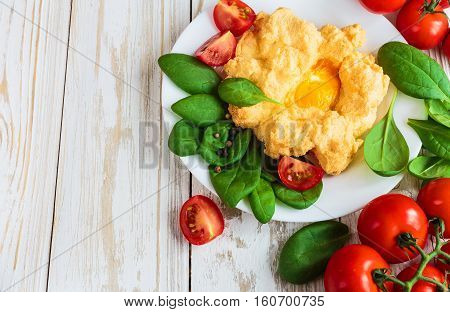 Baked Eggs Orsini With Spinach And Cherry Tomatoes