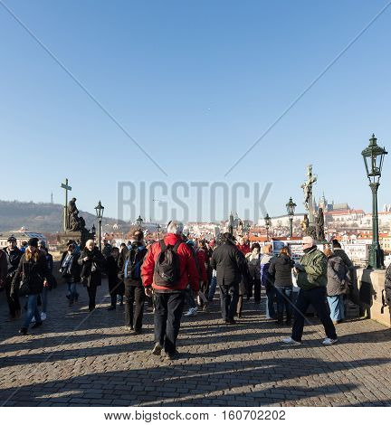Charles Bridge With Crowd Of Tourist
