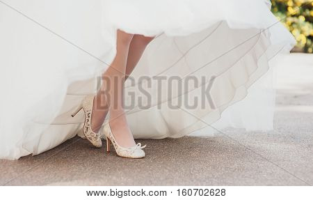 bride's legs visible under a beautiful wedding dress