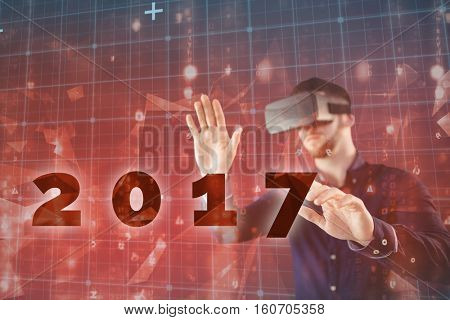 Man using virtual reality simulator against abstract background