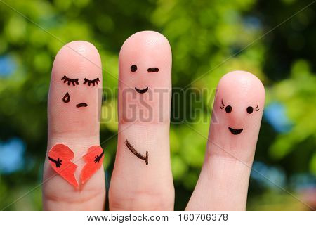 Finger art of people. Man flirts with woman. Other girl is holding broken heart. Concept of cheating in relationship.
