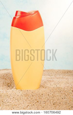 suntan plastic bottle on the sand. Protection