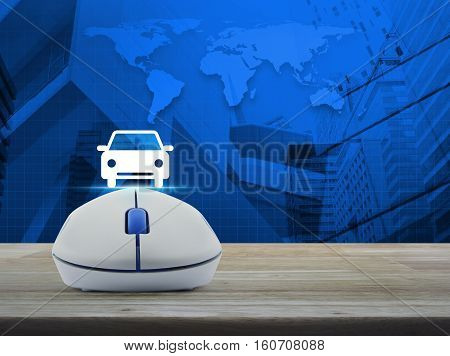 Wireless computer mouse with car front view flat icon on wooden table over world map and city tower background Internet service car concept Elements of this image furnished by NASA