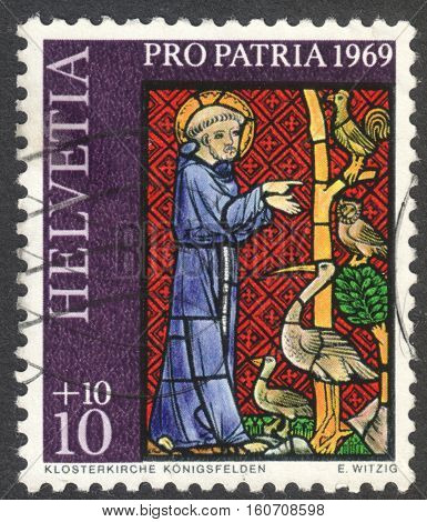 MOSCOW RUSSIA - CIRCA NOVEMBER 2016: a post stamp printed in SWITZERLAND shows Franciscus of Assisi preaching the birds the series
