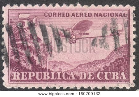 MOSCOW RUSSIA - CIRCA NOVEMBER 2016: a post stamp printed in CUBA shows a plane Airmail - For Domestic Use circa 1931