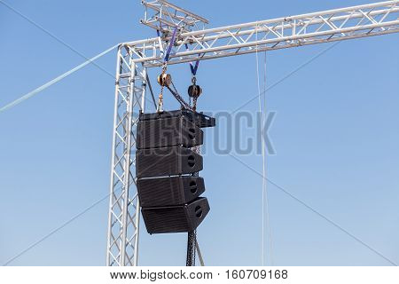 Setting of stage sound equipment. Powerful stage concerto industrial audio speakers