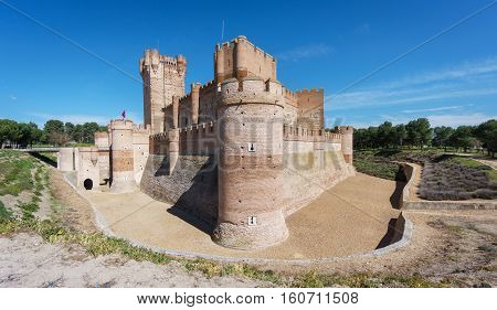 Wide angle view of corner of Castillo de la Mota in Medina del Campo with blue sky, Castille, Spain