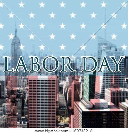 Labor day text against city skyline