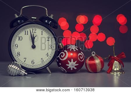 Alarm clock on a background of holiday lights.