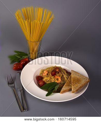 Dish of spaghetti . Bon appetit !