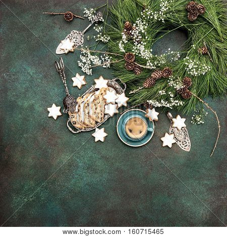 Christmas sweet food star cookies cake Stollen coffee and decoration. Holidays background turquoise stone. Vintage style toned picture