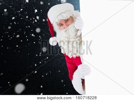 Santa peeking out from behind the wall against digitally generated background