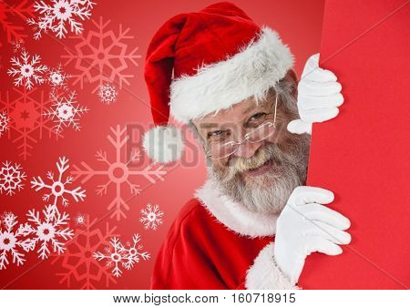Santa peeking out from behind the wall against digitally generated christmas background