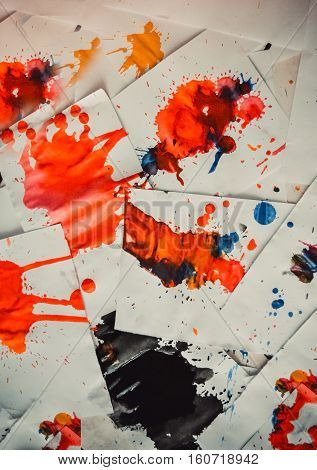 Many red colored blots on white paper with streaks. Abstract creative spots of paint on a white background. Red bright colors. Stained-spattered table poster