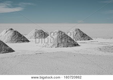Drying Hand-shoveled Salt Piles on Bolivia's Salar de Uyuni, thought to be one of the richest sources of lithium in the world.