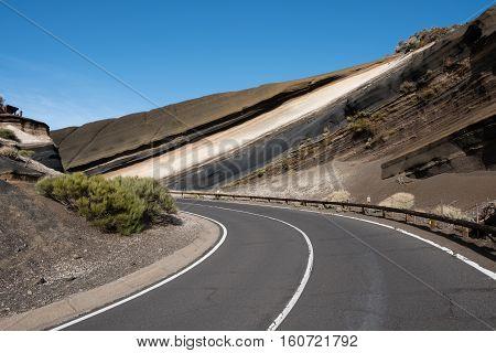 Asphalt Road In Mountain Landscape - Lava Rock Formation