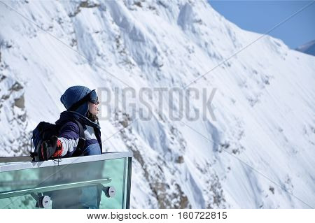 Skier Woman Sunbathing And Relaxing On A Balcony