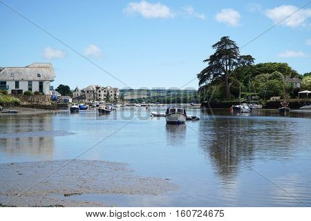 Small boats and mud flats at low tide in the Kingsbridge estuary, Devon, England