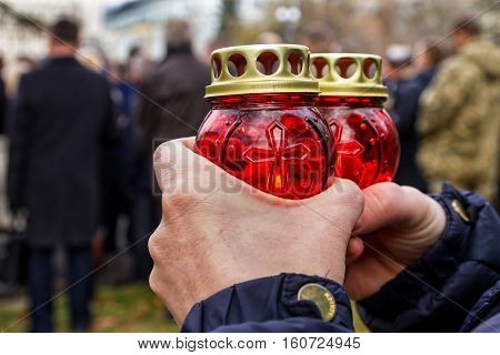 Uzhgorod Ukraine - November 26 2016: A woman holding a candle during the commemoration of the Holodomor victims.