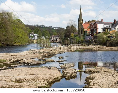 River Dee and rocks looking towards the centre of Llangollen Wales.